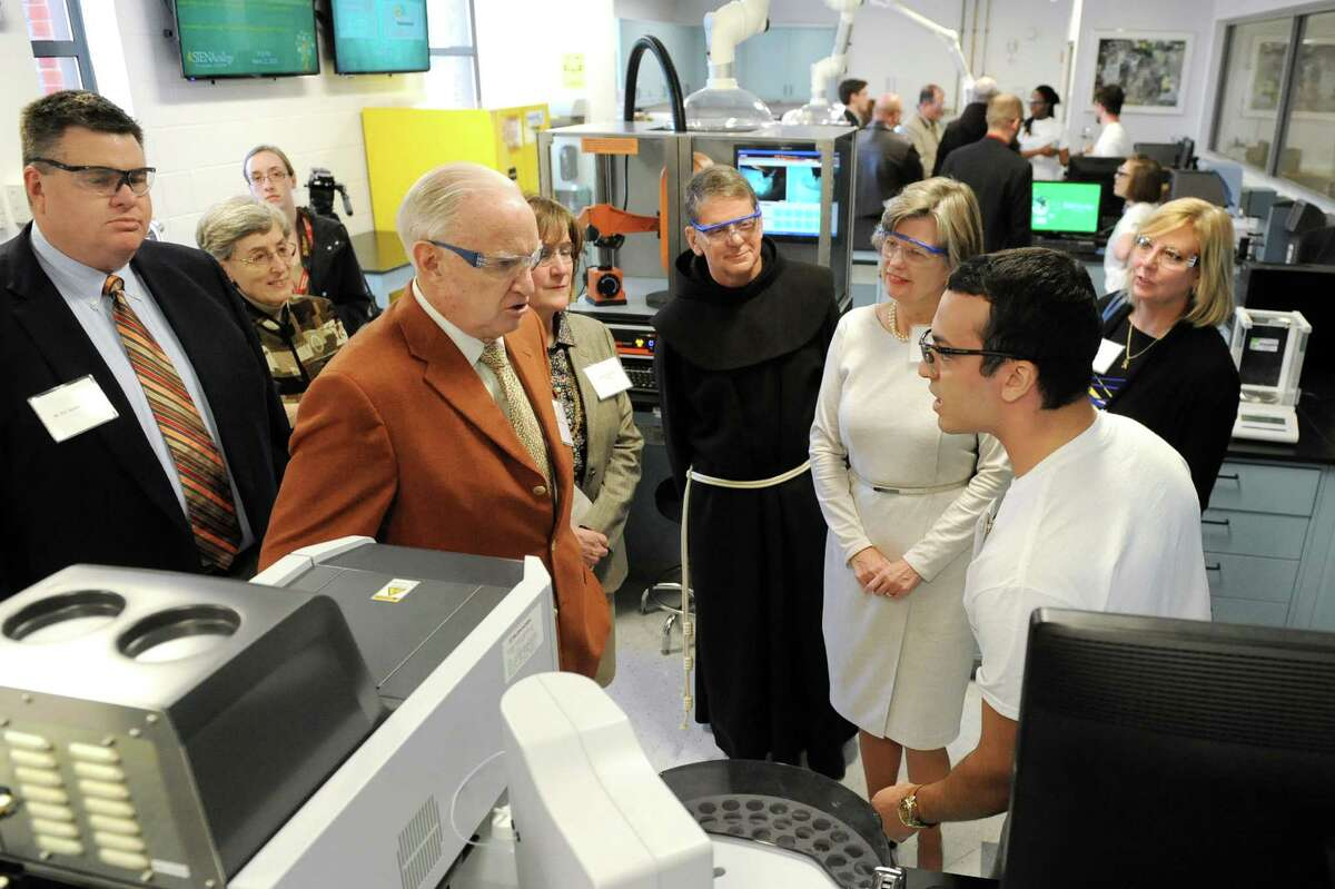 Manny Pena, 19, right, takes a question from William Dake, center, about the auto sampler during a tour of Stewart's Advanced Instrumentation and Technology Center on Thursday, March 12, 2015, at Siena College in Loudonville, N.Y. The center is made possible through an endowment from William and Susan Dake. (Cindy Schultz / Times Union)