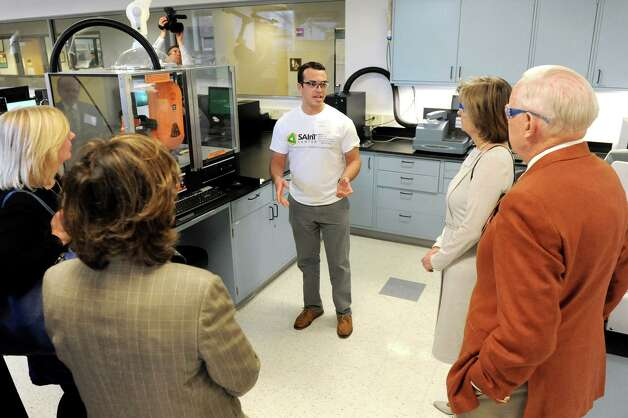 Manny Pena, 19, addresses trustees about the auto sampler during a tour of Stewart's Advanced Instrumentation and Technology Center on Thursday, March 12, 2015, at Siena College in Loudonville, N.Y. (Cindy Schultz / Times Union) Photo: Cindy Schultz / 00030961A