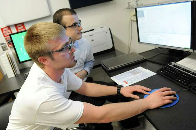 Zack Gregg, 20, left, and Ryan Donahue, 21, show the findings from a piece of equipment during a tour of Stewart's Advanced Instrumentation and Technology Center on Thursday, March 12, 2015, at Siena College in Loudonville, N.Y. (Cindy Schultz / Times Union) Photo: Cindy Schultz / 00030961A