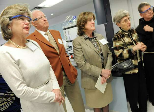 On a tour of Stewart's Advanced Instrumentation and Technology Center, from left, is trustee Susan Dake, her husband William Dake, trustee Pamela McCarthy, trustee Sister Violet Grennan, and college president Brother F. Edward Coughlin on Thursday, March 12, 2015, at Siena College in Loudonville, N.Y. The center is made possible through an endowment from the Dakes. (Cindy Schultz / Times Union) Photo: Cindy Schultz / 00030961A