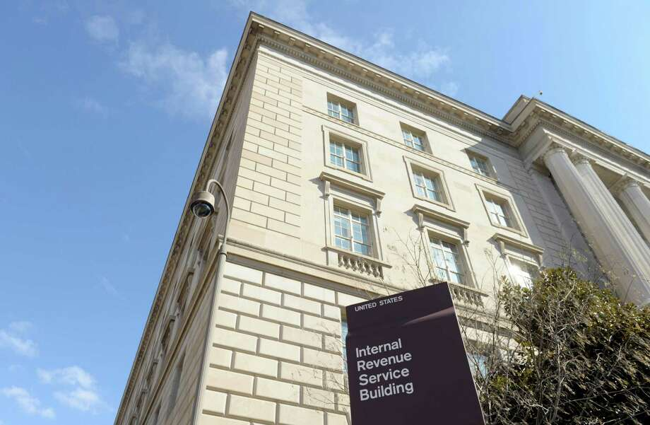 FILE - This March 22, 2013, file photo, shows exterior of the Internal Revenue Service building in Washington. Fake IRS agents have targeted more than 366,000 people with harassing phone calls demanding payments and threatening jail as part of a huge nationwide tax scam that has cost taxpayers $15.5 million. More than 3,000 people have fallen for the ruse since 2013, Timothy Camus, a Treasury deputy inspector general for tax administration, said Thursday, March 12, 2015. (AP Photo/Susan Walsh, File) Photo: Susan Walsh, STF / AP