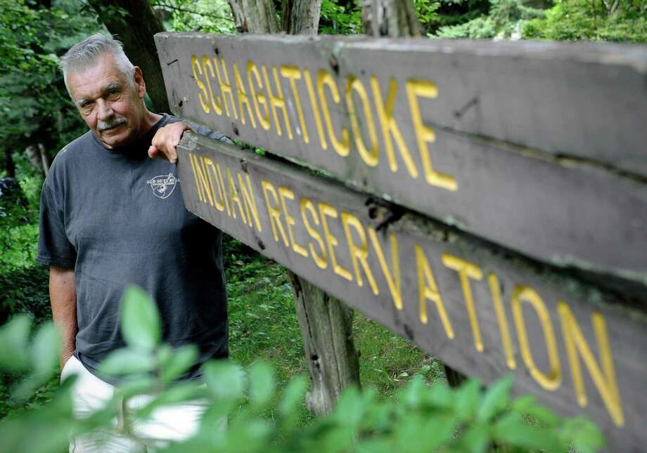 FILE - In this Aug. 7, 2013 file photo, Alan Russell, chairman of the Schaghticoke tribe stands on the reservation land in Kent, Conn. With his tribe left behind by a plan for up to three more casinos in Connecticut, Russell said it may pursue a gambling facility on its small, nearly empty reservation alongside the Appalachian Trail. (AP Photo/Jessica Hill, File) Photo: Jessica Hill, FRE / FR125654 AP