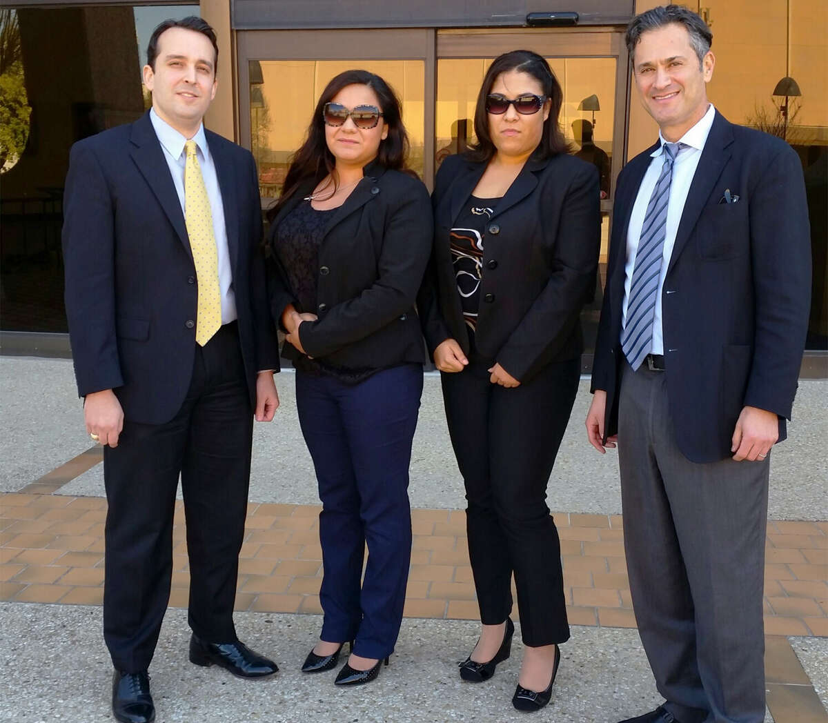 From left, lawyer Rick Prieto, former exotic dancers Alexis Alex and Nicolette Prieto, and attorney Robert Debes, stand outside San Antonio's federal court after winning a wage lawsuit against Tiffany's Cabaret. Picture taken Thursday, March 12, 2015.
