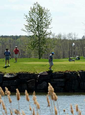 With temperatures in the 80's Golfers are out in force.  This foursome tries to find their next shot at the north end of Saratoga National Golf Course Monday afternoon May 12, 2014 in Saratoga Springs, N.Y.       (Skip Dickstein / Times Union) Photo: SKIP DICKSTEIN