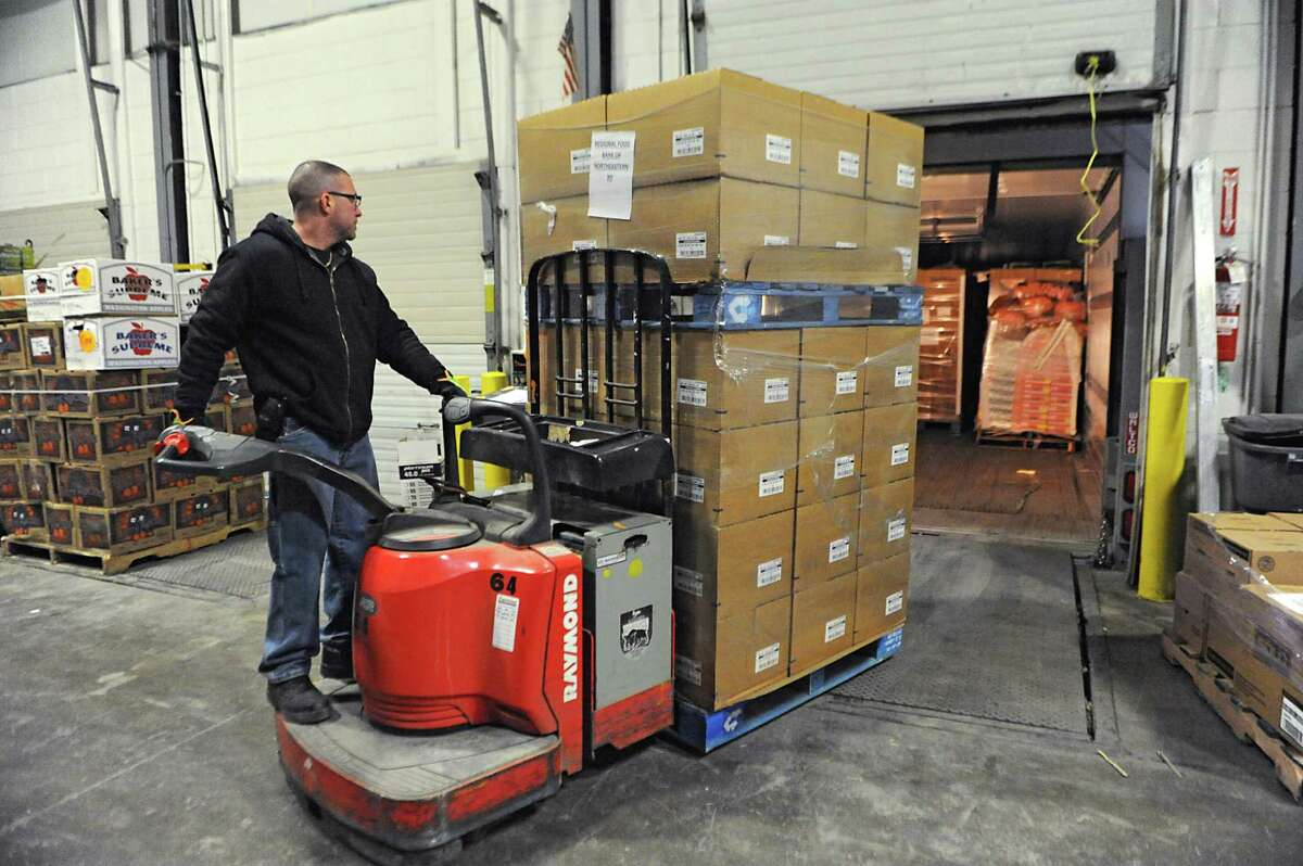 Regional Food Bank of Northeastern New York worker Mike Swart uses a fork lift to unload a truck as Hannaford Supermarkets delivers 731 cases of food on Thursday, March 12, 2015 in Latham, N.Y. (Lori Van Buren / Times Union)