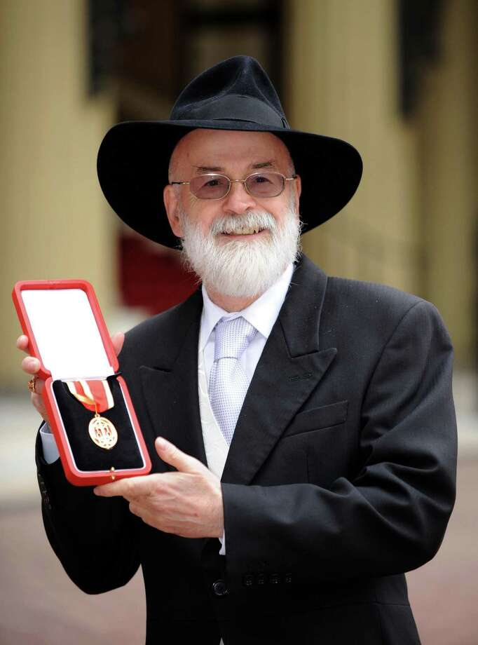 (FILES) A file picture taken on February 18, 2009, shows British author Sir Terry Pratchett posing for pictures with his knighthood award outside Buckingham Palace in London. British science fiction and fantasy author Terry Pratchett, whose Discworld novels have sold tens of millions of copies worldwide, died on Thursday March 12, 2015, at the age of 66, his publisher said.  AFP PHOTO / IAN NICHOLSON/FILESIAN NICHOLSON/AFP/Getty Images Photo: IAN NICHOLSON, Stringer / AFP