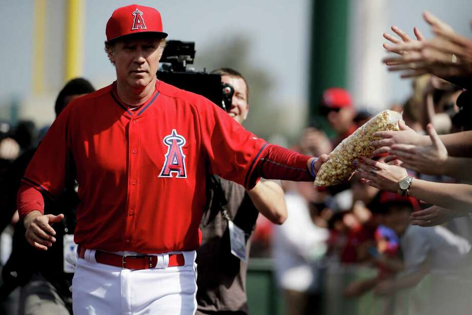 Will Ferrell arrives at a spring training game in Tempe, Ariz. The comedian played every position for teams in five Arizona games on Thursday, raising money for college scholarships for cancer survivors. Photo: Chris Carlson, STF / AP