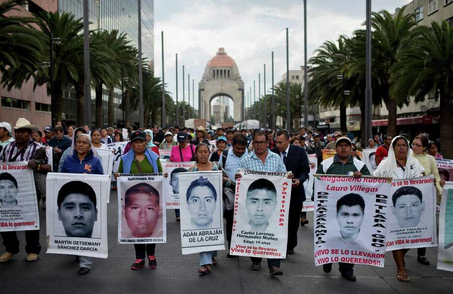 The parents of 43 missing college students have no concrete information on what happened to their children. They protest the decreasing news coverage and demand that their voices be aired and the search continue. Photo: Eduardo Verdugo, STF / AP