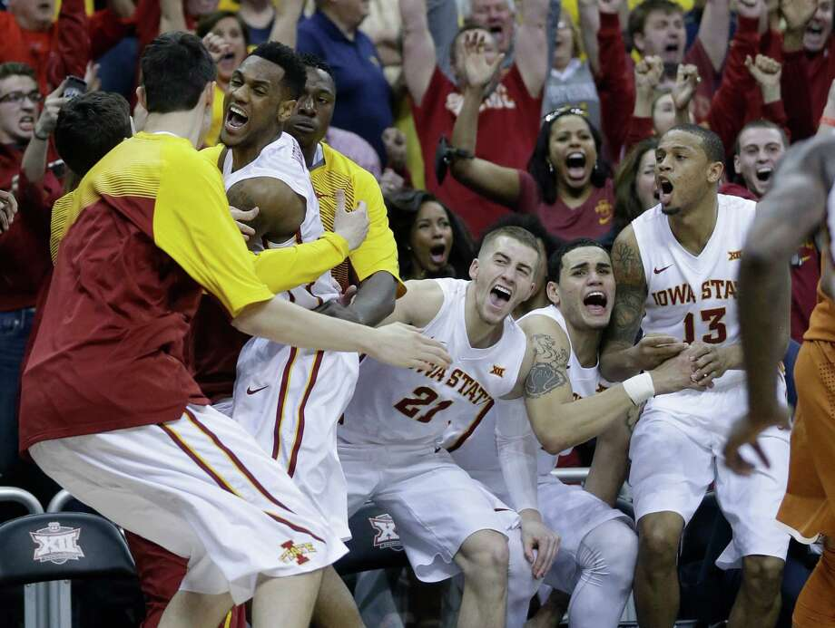 Iowa State guard Monte Morris, second from left, celebrates his last-second game-winning basket with his team after an NCAA college basketball game in the quarterfinals of the Big 12 Conference tournament in Kansas City, Mo., Thursday, March 12, 2015. Iowa State defeated Texas 69-67. (AP Photo/Orlin Wagner) Photo: Orlin Wagner, STF / AP