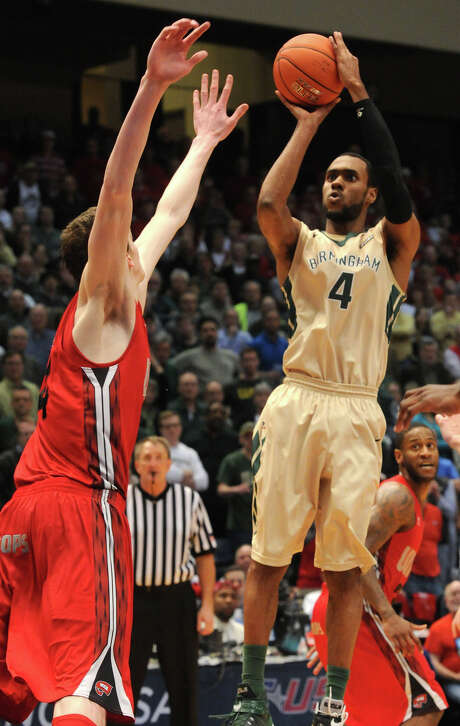UAB's Robert Brown goes up with the go-ahead basket over Western Kentucky's Ben Lawson during the second half of a Conference USA tournament second-round NCAA college basketball game in Birmingham, Ala., Thursday, March 12, 2015. UAB won 53-52. (AP Photo/AL.com, Mark Almond) Photo: MARK ALMOND, MBI / AL.COM