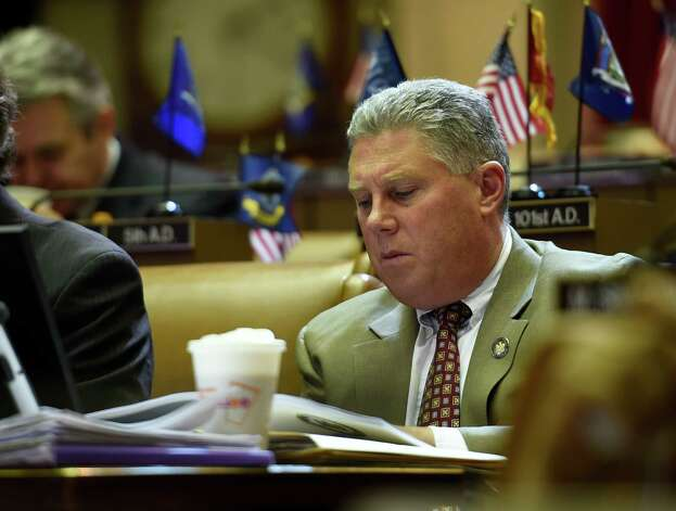 Assemblyman John McDonald looks over the Executive Budget publication during session Thursday afternoon, March 12, 2015, at the Capitol in Albany, N.Y.  (Skip Dickstein/Times Union) Photo: SKIP DICKSTEIN