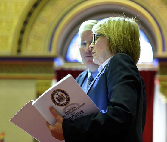 Assembly members Michael Kearns, left, and Eileen Gunther discuss the Executive Budget submission in the Assembly Chamber Thursday afternoon, March 12, 2015, at the Capitol in Albany, N.Y.  (Skip Dickstein/Times Union) Photo: SKIP DICKSTEIN