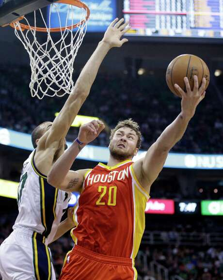Utah Jazz center Rudy Gobert (27) defends against Houston Rockets forward Donatas Motiejunas (20) in the second quarter of an NBA basketball game Thursday, March 12, 2015, in Salt Lake City. (AP Photo/Rick Bowmer) Photo: Rick Bowmer, STF / AP