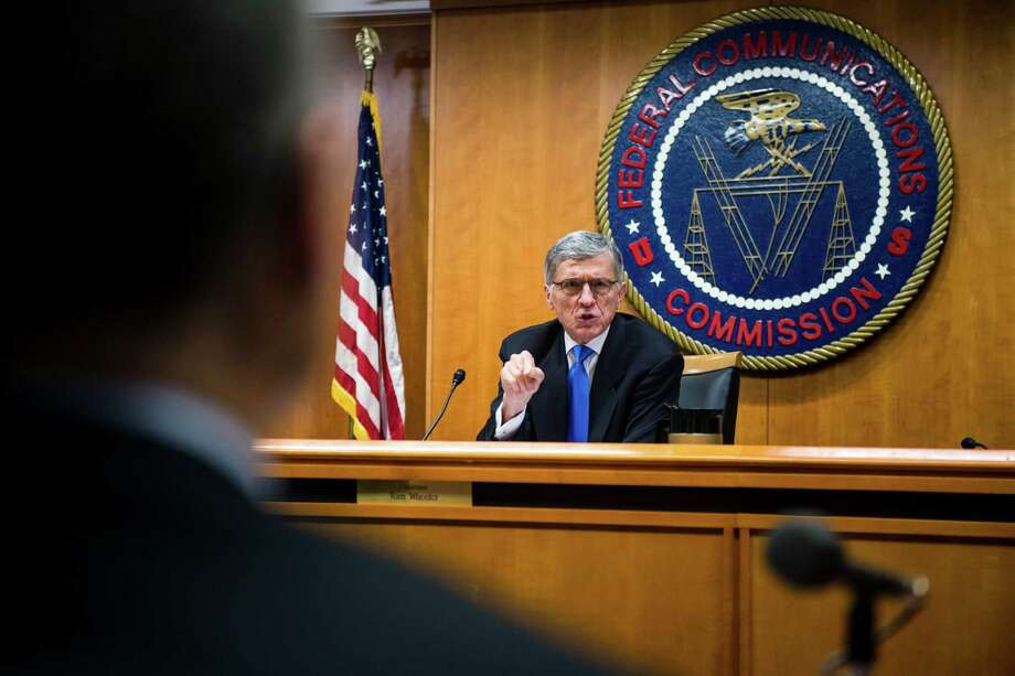 FILE -- Tom Wheeler, chairman of the U.S. Federal Communications Commission during a meeting on community broadcast and net neutrality in Washington, Feb. 26, 2015. Two weeks after voting to regulate broadband Internet service as a public utility, the FCC on Thursday released 313 pages of rules detailing what would be allowed. (Gabriella Demczuk/The New York Times) Photo: GABRIELLA DEMCZUK, STR / NYTNS