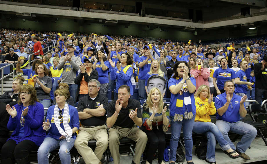 Brock fans cheer as their team plays Kountze in the 3A semifinals of the UIL state boys basketball tournament at the Alamodome on March 12, 2015. Photo: Tom Reel / San Antonio Express-News