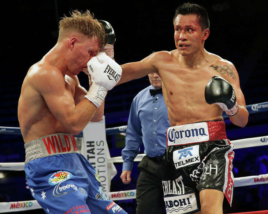 Francisco Vargas punishes with shots to the face as he fights Will Tomlinson in the feature boxing event at Freeman Coliseum on March 12, 2015. Photo: San Antonio Express-News