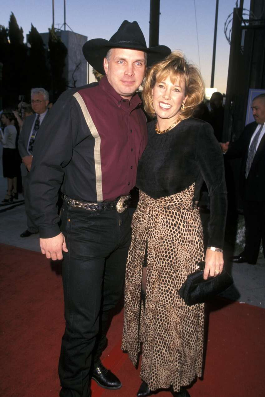 Garth Brooks and his college girlfriend Sandy Mahl split in 2000 after 14 years of marriage. Mahl received a $125 million settlement.