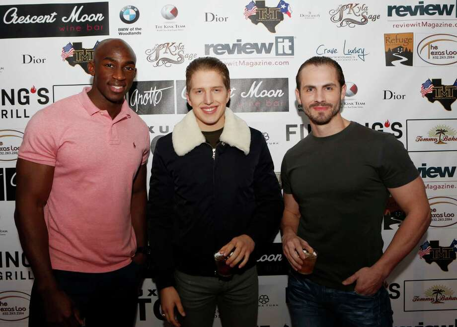 Michael Otule, Matt Necher and Chip Blalock on the red carpet at the Fashion Woodlands fashion show at Crave Luxury Auto. Photo: Jon Shapley, Houston Chronicle / © 2015 Houston Chronicle