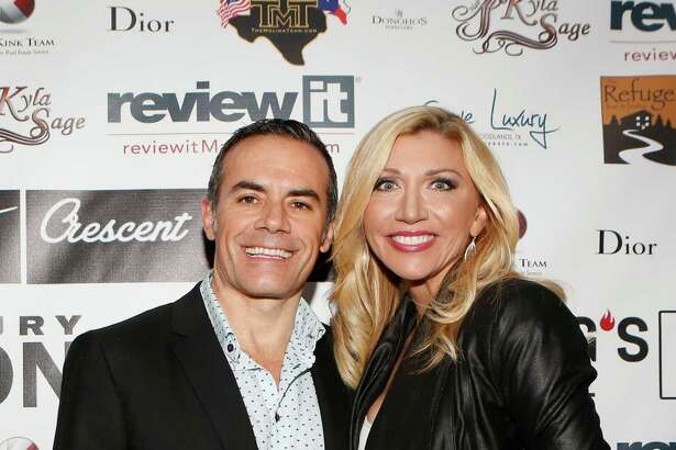Rafael Lugo and Christine Haas on the red carpet at the Fashion Woodlands fashion show at Crave Luxury Auto.