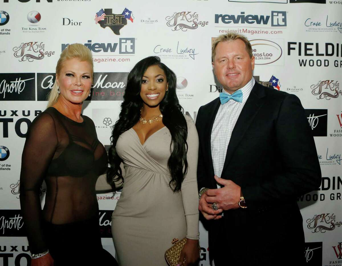 Theresa Roemer, Porsha Williams and Roger Clemens on the red carpet at the Fashion Woodlands fashion show at Crave Luxury Auto.