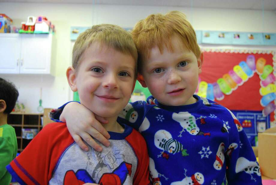 Sean Gochee, left, and Colton Stafford get a kick out of wearing PJs to school. Photo: Contributed Photo / Darien News