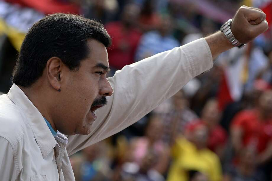 Venezuelan President Nicolaas Maduro delivers a speech before supporters outside the presidential palace in Caracas in March. Photo: Federico Parra, AFP / Getty Images