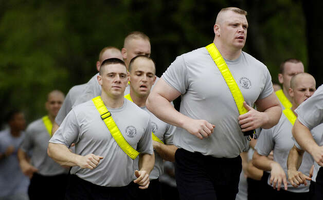 In this 2006 file photo New York State Police recruits are shown during their three mile morning run around the University at Albany campus.  (Skip Dickstein/Times Union archive) Photo: SKIP DICKSTEIN / ALBANY TIMES UNION