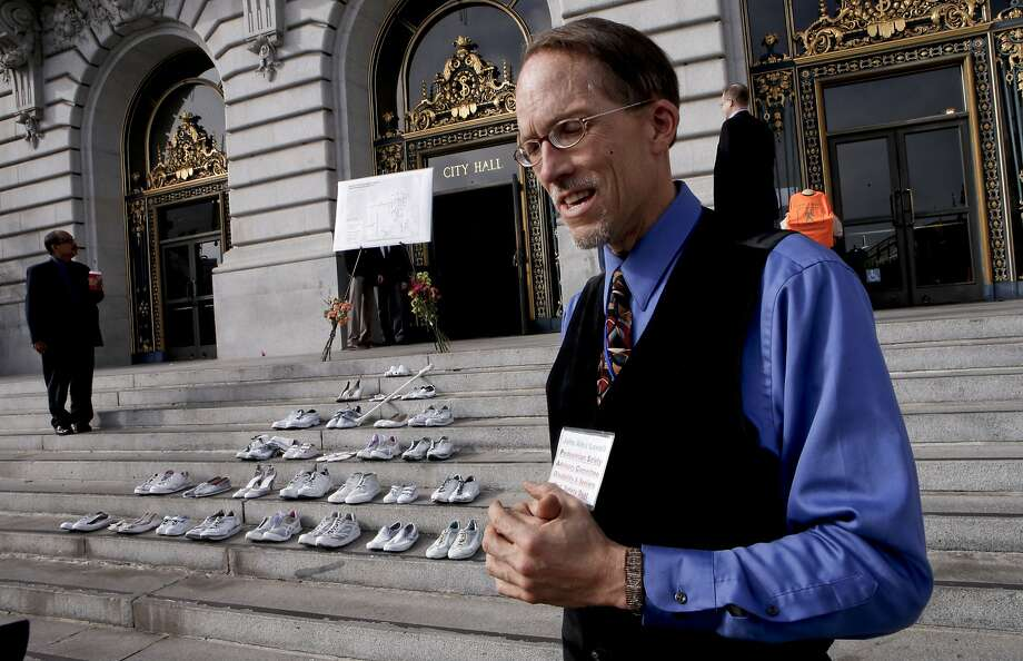 John Lowell, on Friday Nov. 7, 2014, who holds a seat on the Pedestrian Safety Advisory Committee, near the steps of City Hall where twenty eight pairs of shoes have been placed to represent the lives lost in 2014 to traffic related incidents. Members of San Francisco's Vision Zero Coalition gathered in San Francisco, Calif., to draw attention to the alarming increase of traffic related deaths on the streets of the city. Photo: Michael Macor, The Chronicle