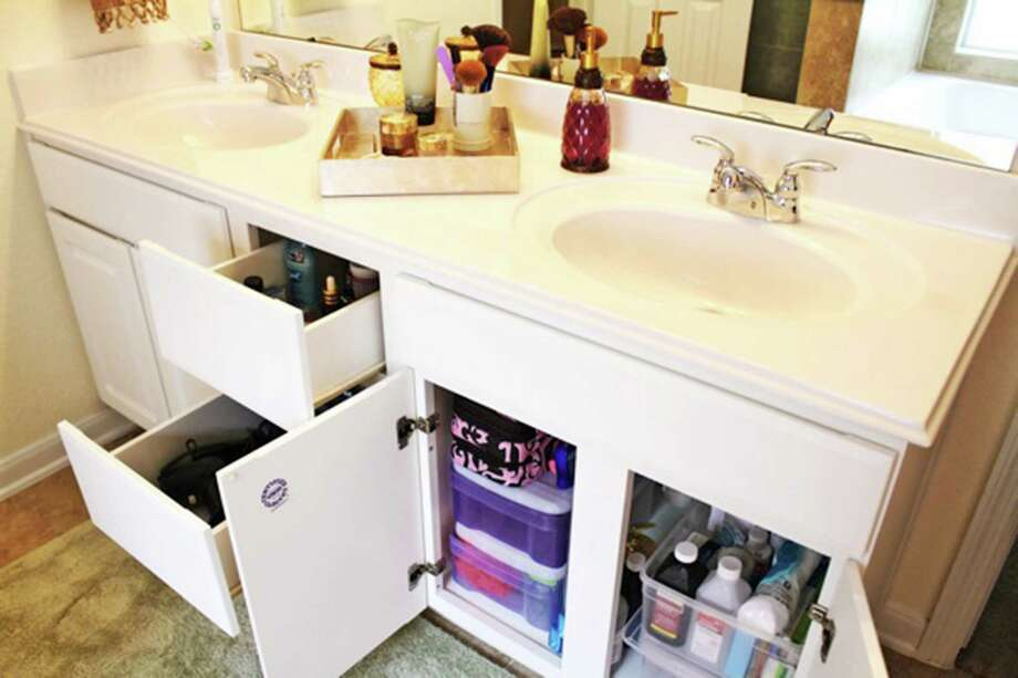 A tray on the vanity can corral items used every day. Photo: Courtesy Tammy Atchison / TNS