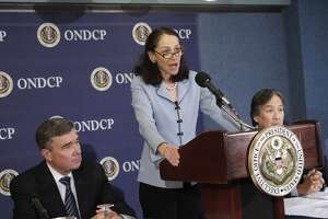 Food and Drug Administration (FDA) Commissioner Margaret Hamburg, center, accompanied by Office of National Drug Control Policy Director  Gil Kerlikowske, left, and Health and Human Services Assistant Secretary Howard Koh, speaks during a news conference at the National Press Club in Washington, Tuesday, April 19, 2011, to announce new prescription drug safety measures and a plan to fight prescription drug abuse.  (AP Photo/J. Scott Applewhite)