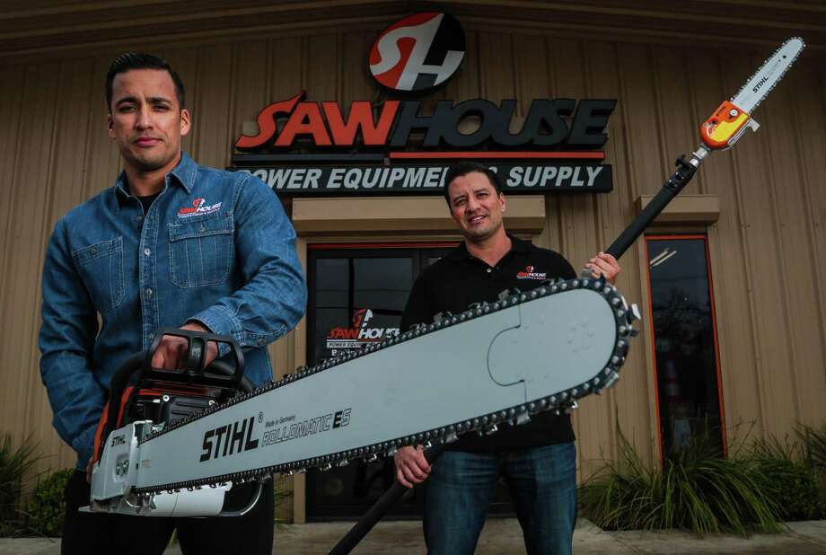 Brothers Hector, left, and Jose Cantu sell chain saws, lawn mowers, tree trimmers and other equipment from their standalone shop, SawHouse. Photo: Billy Smith II / © 2015 Houston Chronicle