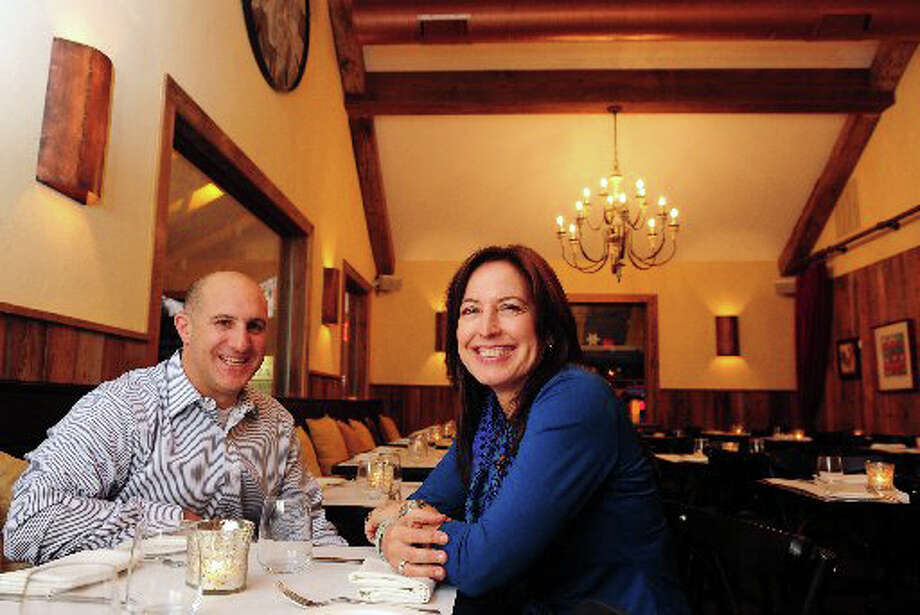 Greg Addonizio and wife Debra Ponzek, owners of Aux Delices Bistro in Westport, Conn., sit in the dining room of their restaurant. They will be the featured speakers at the 10:30 a.m. Wednesday meeting of the Retired Men's Association set for 10:30 a.m. at First Presbyterian Church, Lafayette Place, Greenwich. Photo: Contributed Photo / Greenwich Time Contributed