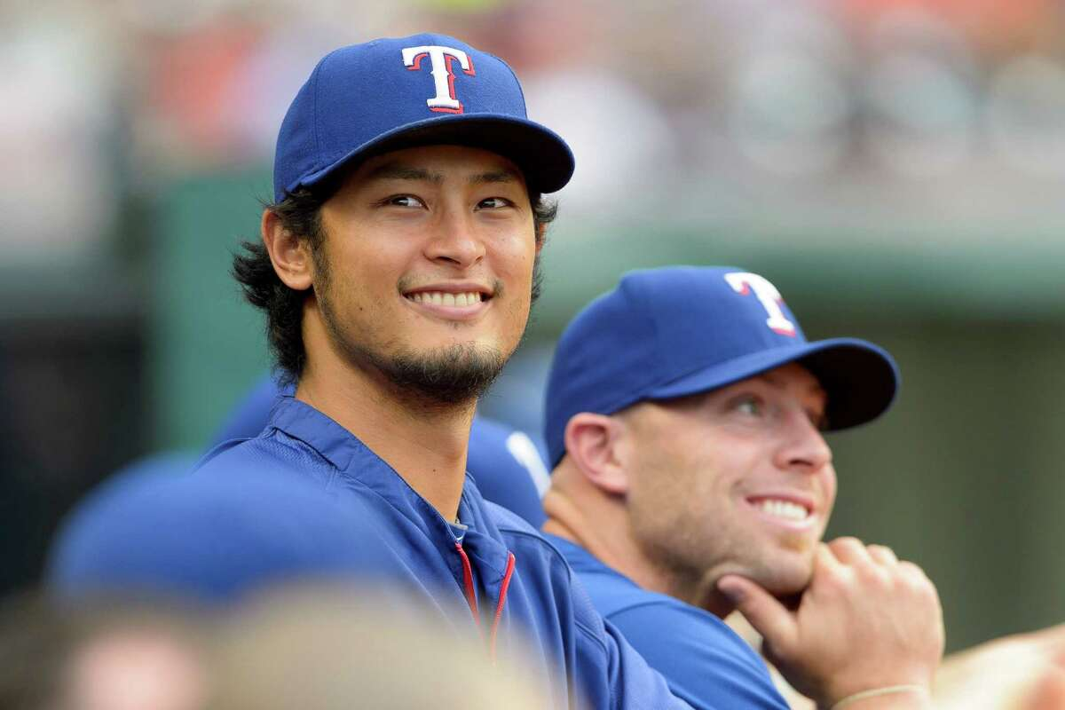 Pitcher Yu Darvish of the Texas Rangers watches the game from the dugout during the second inning against the Indians at Progressive Field on Aug. 1, 2014 in Cleveland, Ohio.