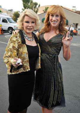 """FILE - March 12, 2015: Comedian Kathy Griffin is leaving """"E! Fashion Police"""" after seven episodes STUDIO CITY, CA - JULY 26:  Comedians Joan Rivers and Kathy Griffin arrive at the Comedy Central Roast of Joan Rivers held at CBS Studios on July 26, 2009 in Studio City, California.  (Photo by Kevin Winter/Getty Images)"""