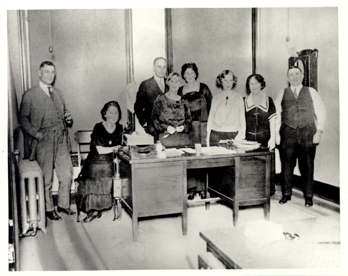 Group portrait of USAA's staff in the Calcasieu Building office, Dec. 26, 1923. From left to right: Robert G. Caldwell, Elsie Reinarz, William B. Loughborough,
