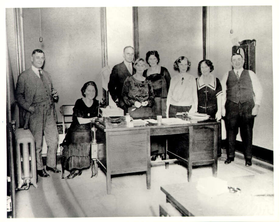 """Group portrait of USAA's staff in the Calcasieu Building office, Dec. 26, 1923. From left to right: Robert G. Caldwell, Elsie Reinarz, William B. Loughborough, """"Poppie"""" Armstrong, Martha Harvin, Virginia Gion, Adelaide Bloom and S.D. Smith. Photo: Courtesy Photo / USAA Historical Collection"""