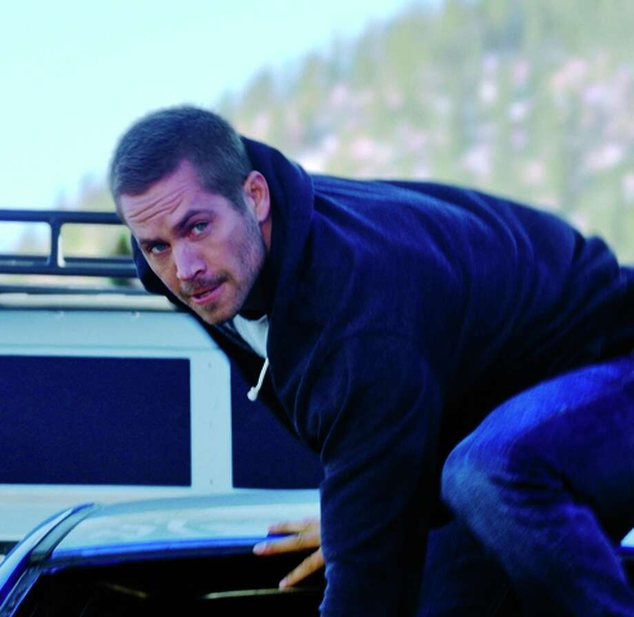 "Paul Walker in ""Furious 7,"" the franchise's latest installment. Photo: Relativity Media / Relativity Media / ONLINE_YES"