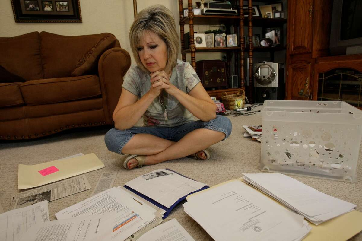Anita Goodman looks of the box of information Monday, July 12, 2010, in Vidor that she was collected about pill mills, prescription overdose and also information about the her son, Aaron Goodman, who died of a prescription overdose Feb. 23, 2006. She has been a catalyst for reforms on prescription drugs in Texas. ( Melissa Phillip / Houston Chronicle )