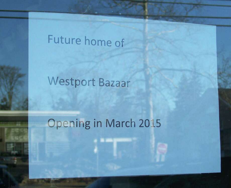 A sign on the window of the former Silver of Westport store announces that a new business will be moving in. Although the sign says March, the grand opening of the cooperative is actually slated for April 15. Photo: Anne M. Amato, A / westport news
