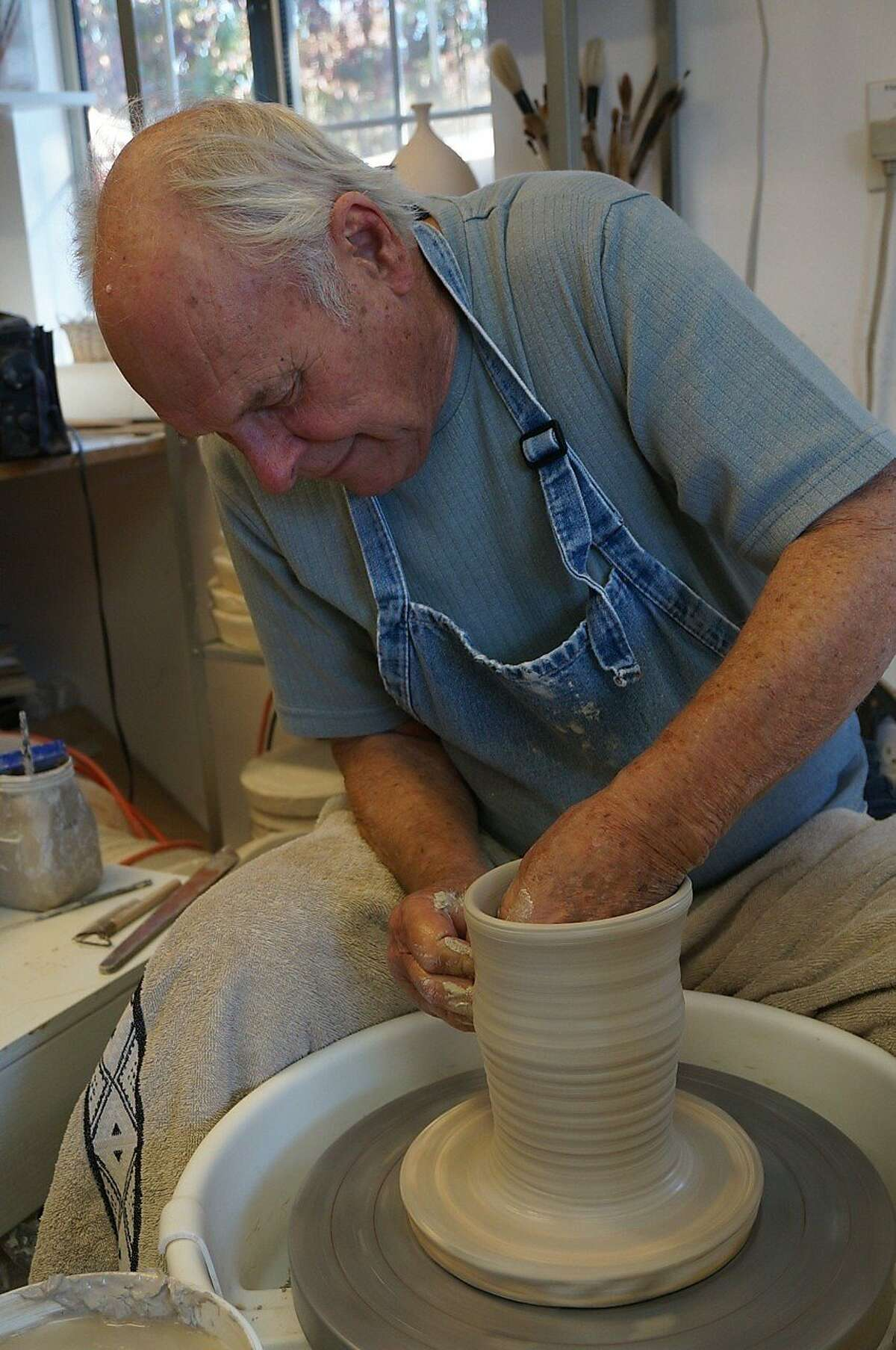 Larry Carnes, potter, right, is part of the Backyard Artist &and Wine tour with Cloud Climbers.