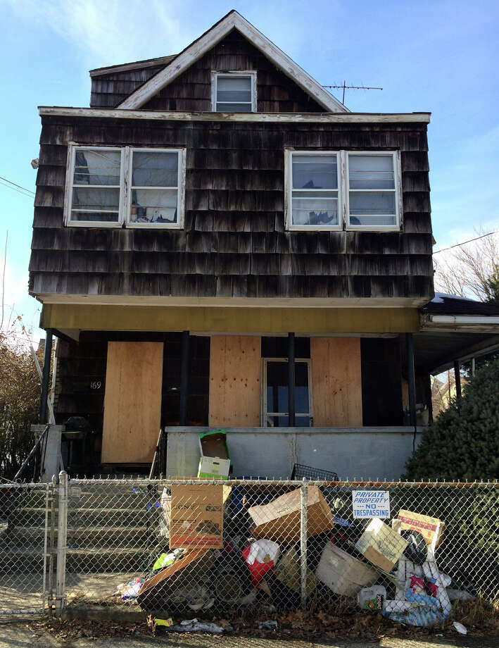 An exterior of a home along Goddard Avenue which was condemned in Bridgeport, Conn., on Friday Mar. 13, 2015. Bridgeport Public Safety took 68 animals, most of them dogs, from the home. Photo: Christian Abraham / Connecticut Post