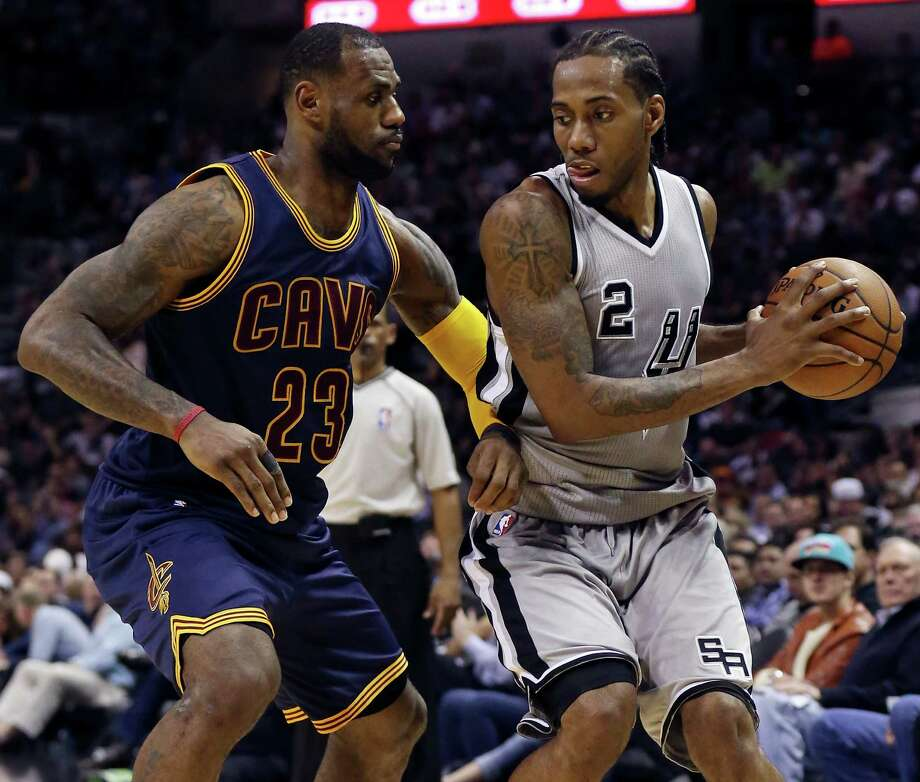 Cleveland Cavaliers' LeBron James defends the Spurs' Kawhi Leonard during first half action on March 12, 2015 at the AT&T Center. Photo: Edward A. Ornelas /San Antonio Express-News / © 2015 San Antonio Express-News