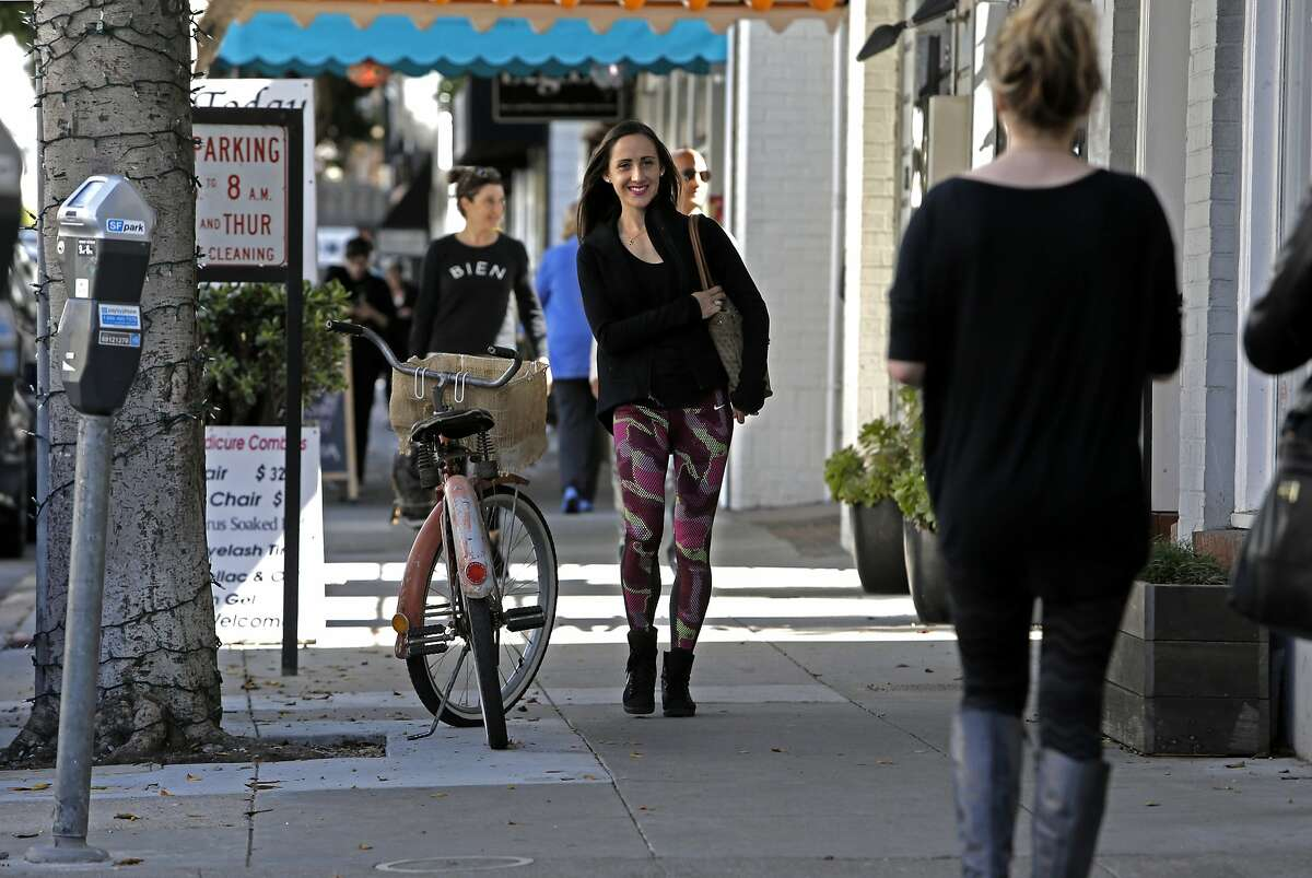 Shannon Rowbury, walks along Union St.