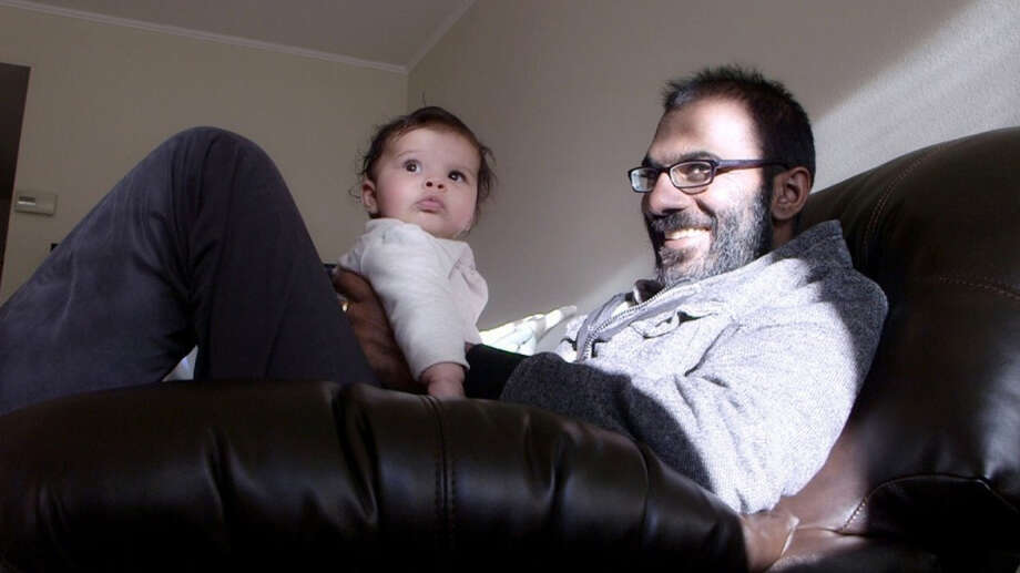 Stanford University neurosurgeon Paul Kalanithi savors a moment with his daughter, Cady, earlier this year. Kalanithi, who had never smoked, was diagnosed with lung cancer in 2013. He died March 9 at the age of 37. Photo: Mark Hanlon, Stanford University School Of Medicine