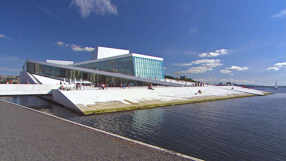Oslo's Opera House rises from the water on the city's eastern harbor. Photo: Rick Steves / ONLINE_YES