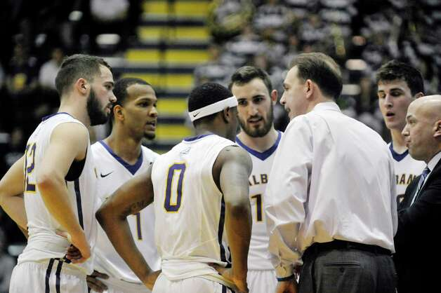 UAlbany head coach Will Brown talks to his players during a timeout in their game against New Hampshire on Sunday, March 8, 2015, in Albany, N.Y.    (Paul Buckowski / Times Union) Photo: PAUL BUCKOWSKI / 00030901A