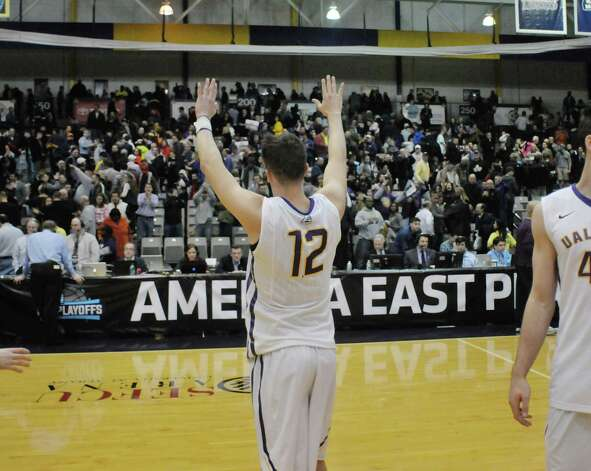 Peter Hooley of UAlbany waves to the crowd after their win over New Hampshire in their America East semifinal game on Sunday, March 8, 2015, in Albany, N.Y.    (Paul Buckowski / Times Union) Photo: PAUL BUCKOWSKI / 00030901A
