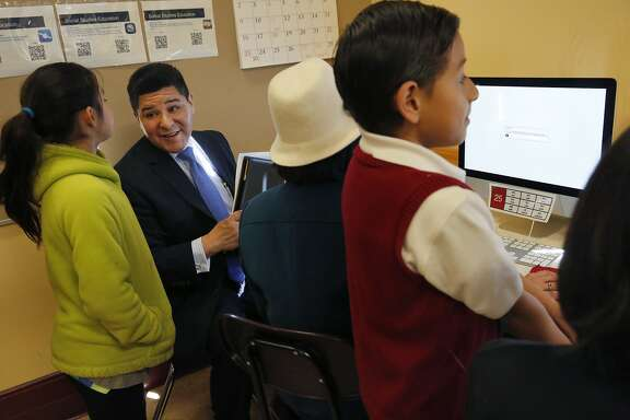 Jailynn Bermudez, 10, left, chats with Superintendent Richard A. Carranza after helping him with a question sample from the new Smarter Balanced Assessments system at a media event showcasing the system that uses the new Common Core curriculum at Cesar Chavez Elementary School March 3, 2015 in San Francisco, Calif. Starting March 10, the computerized system will be put to use across California.