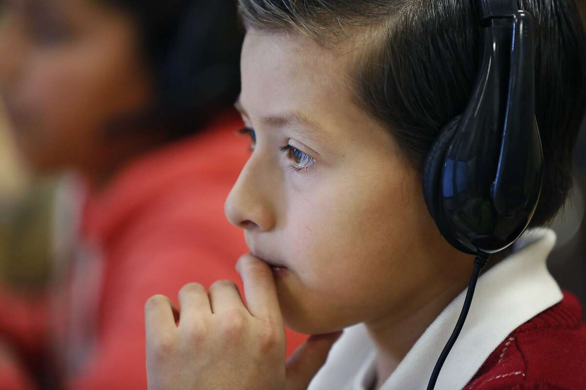 Brandon Arenal, 10, works on sample questions with the new Smarter Balanced Assessments system at a media event showcasing the system that uses the new Common Core curriculum at Cesar Chavez Elementary School March 3, 2015 in San Francisco, Calif. Starting March 10, the computerized system will be put to use across California.