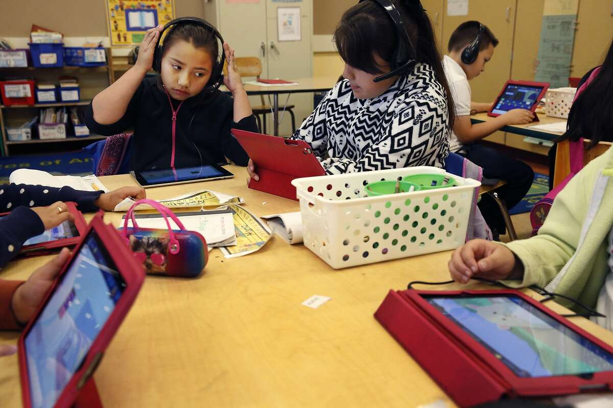 From left, Jessie Torres, 8, Naysa Sierra, 8, Natalie Moreno, 8, Maria Ortega, 8, and Josis Enrique, 8, do work on the Dreambox app that includes Common Core math standards in Mr. Moon's class at Cesar Chavez Elementary School March 3, 2015 in San Francisco, Calif. Starting March 10, the computerized system will be put to use across California.